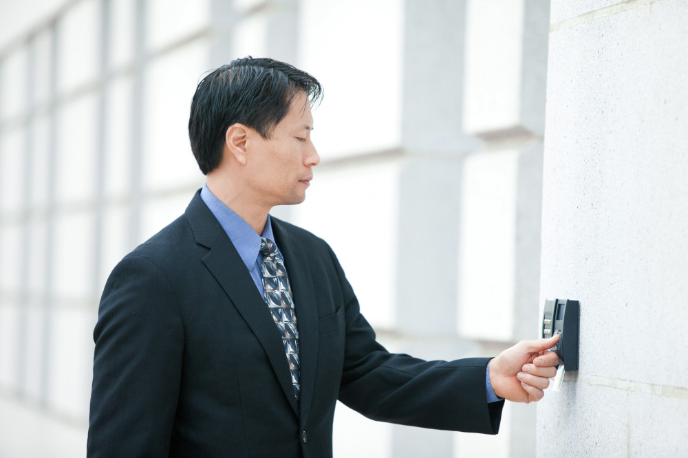 Male employee with biometric reader